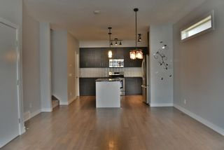 Photo 6: 1 711 17 Avenue NW in Calgary: Mount Pleasant Row/Townhouse for sale : MLS®# A1100885