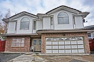 Photo 1: 7086 126A Street in Surrey: West Newton House for sale : MLS®# R2119592