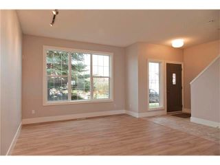 Photo 3: 115 CHAPARRAL RIDGE Way SE in Calgary: Chaparral House for sale : MLS®# C4033795
