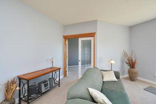 Photo 26: 303 GLENEAGLES View: Cochrane House for sale : MLS®# C4130061