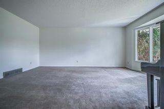 Photo 4: 319 Parkland Way SE in Calgary: Parkland Detached for sale : MLS®# A1102560