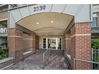 Photo 1: 203 2330 WILSON AVENUE in Port Coquitlam: Central Pt Coquitlam Condo for sale : MLS®# R2325850