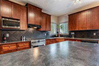 Photo 15: 78 CRYSTAL SHORES Place: Okotoks Detached for sale : MLS®# A1009976
