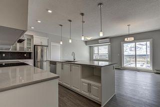 Photo 3: 410 4250 Seton Drive SE in Calgary: Seton Apartment for sale : MLS®# A1140732