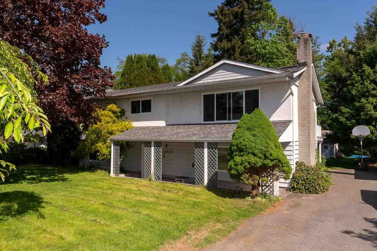 Main Photo: 14295 73A Avenue in Surrey: East Newton House for sale : MLS®# R2581425