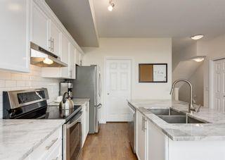 Photo 3: 23 43 Springborough Boulevard SW in Calgary: Springbank Hill Row/Townhouse for sale : MLS®# A1140489