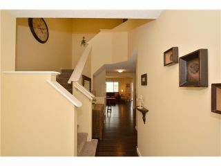 Photo 3: 149 SUNSET Common: Cochrane Residential Attached for sale : MLS®# C3631506