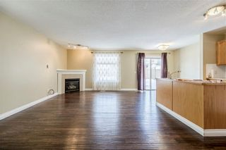 Photo 4: 23 TUSCARORA WY NW in Calgary: Tuscany House for sale : MLS®# C4174470