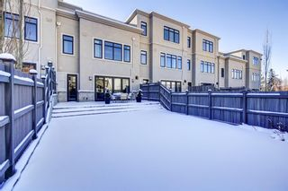 Photo 3: 10 Valour Circle SW in Calgary: Currie Barracks Row/Townhouse for sale : MLS®# A1069872