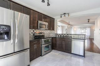 """Photo 7: 20 6747 203 Street in Langley: Willoughby Heights Townhouse for sale in """"Sagebrook"""" : MLS®# R2347657"""