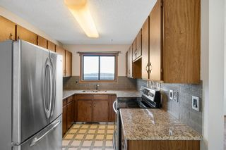 Photo 9: 72 Shawmeadows Crescent SW in Calgary: Shawnessy Detached for sale : MLS®# A1097940