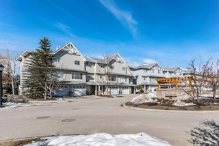 Photo 1: 6 Crystal Shores Cove: Okotoks Row/Townhouse for sale : MLS®# A1080376