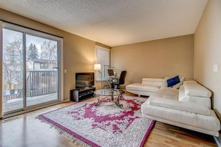 Photo 4: 1309 Ranchlands Road NW in Calgary: Ranchlands Row/Townhouse for sale : MLS®# A1060522