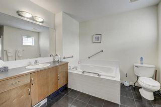 Photo 11: 3 EVERRIDGE Villa SW in Calgary: Evergreen Semi Detached for sale : MLS®# C4297700