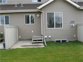 Photo 2: 181 ROYAL OAK Gardens NW in CALGARY: Royal Oak Townhouse for sale (Calgary)  : MLS®# C3484170