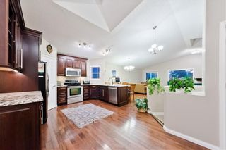 Photo 3: BRIDLEWOOD PL SW in Calgary: Bridlewood House for sale
