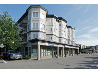 """Photo 1: 403 5759 GLOVER Road in Langley: Langley City Condo for sale in """"COLLEGE COURT"""" : MLS®# F1442596"""