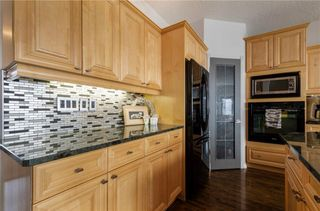Photo 5: 1302 STRATHCONA Drive SW in Calgary: Strathcona Park Detached for sale : MLS®# C4235711