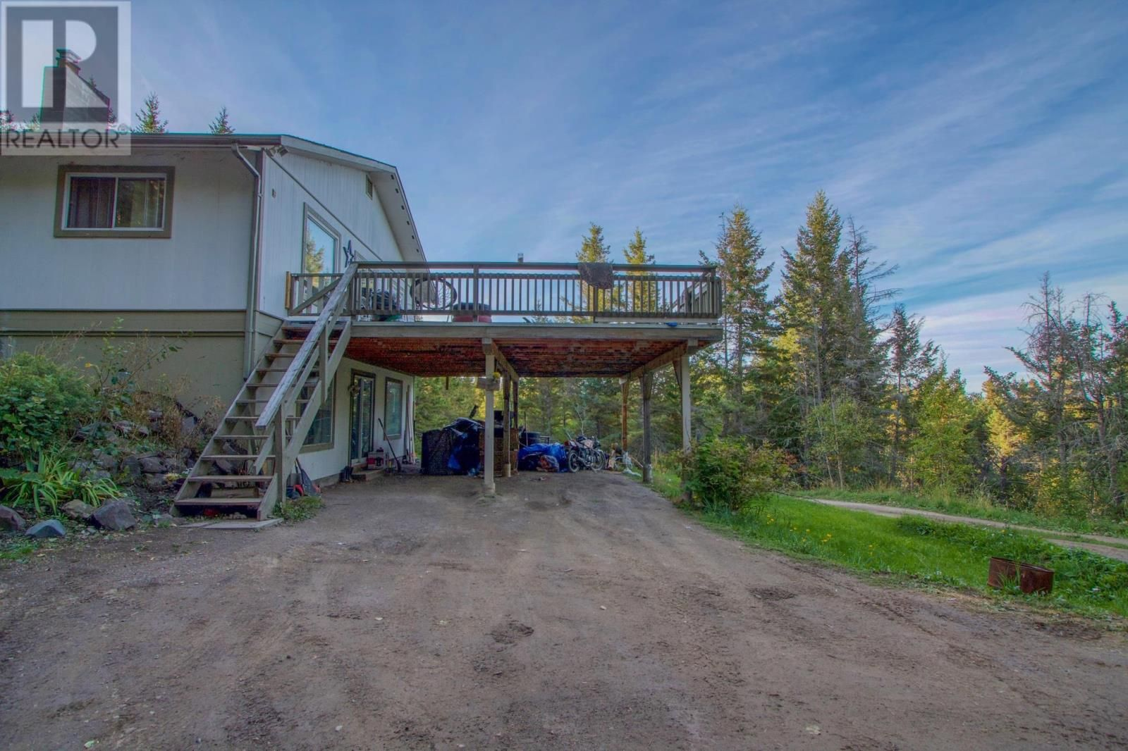 Main Photo: 5328 THOMPSON ROAD in 108 Mile Ranch: House for sale : MLS®# R2617376