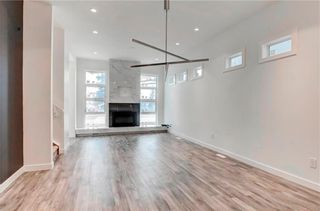 Photo 11: 2 139 24 Avenue NE in Calgary: Tuxedo Park Row/Townhouse for sale : MLS®# A1064305