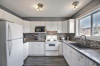 Photo 12: 226 Quigley Drive: Cochrane Semi Detached for sale : MLS®# A1107845