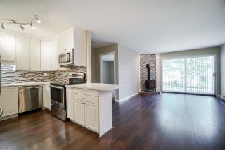"""Photo 1: 102 5379 205 Street in Langley: Langley City Condo for sale in """"Heritage Manor"""" : MLS®# R2447555"""