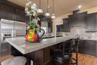 Photo 10: 5978 131A Street in Surrey: Panorama Ridge House for sale : MLS®# R2576432