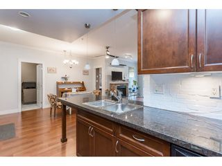 """Photo 7: 109 33338 MAYFAIR Avenue in Abbotsford: Central Abbotsford Condo for sale in """"The Sterling"""" : MLS®# R2558844"""