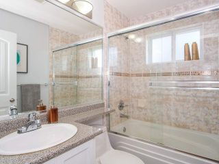 Photo 14: 2151 TRIUMPH Street in Vancouver: Hastings Sunrise 1/2 Duplex for sale (Vancouver East)  : MLS®# R2412946