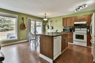 Photo 4: 93 Rocky Vista Circle NW in Calgary: Rocky Ridge Row/Townhouse for sale : MLS®# A1071802