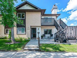 Main Photo: 15 Cedar Spring Gardens SW in Calgary: Cedarbrae Row/Townhouse for sale : MLS®# A1103133