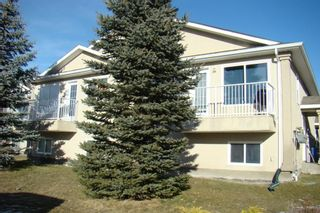 Photo 1: 15 Highlands Place W in Lethbridge: West Highlands Multi-Family for sale : MLS®# A1054611