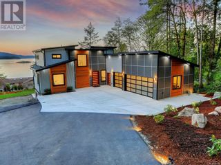 Photo 1: 1470 Lands End Rd in North Saanich: House for sale : MLS®# 884199