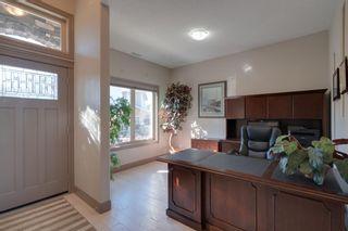 Photo 28: 40 Cougar Ridge Landing SW in Calgary: Cougar Ridge Row/Townhouse for sale : MLS®# A1148928