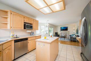 "Photo 9: 8576 142 STREET Street in Surrey: Bear Creek Green Timbers House for sale in ""Brookside"" : MLS®# R2598904"