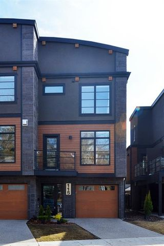 Photo 1: 115 41 Avenue SW in Calgary: Parkhill Row/Townhouse for sale : MLS®# A1100085