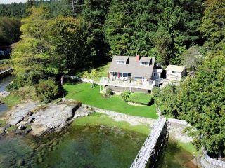 Photo 1: 4760 SINCLAIR BAY Road in Garden Bay: Pender Harbour Egmont House for sale (Sunshine Coast)  : MLS®# R2607231