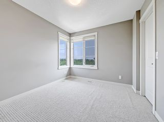 Photo 25: 27 Aspen Hills Common SW in Calgary: Aspen Woods Row/Townhouse for sale : MLS®# A1134206