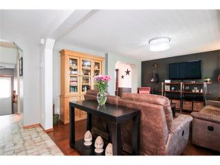 Photo 5: 390 ELGIN Way SE in Calgary: McKenzie Towne House for sale : MLS®# C4019083