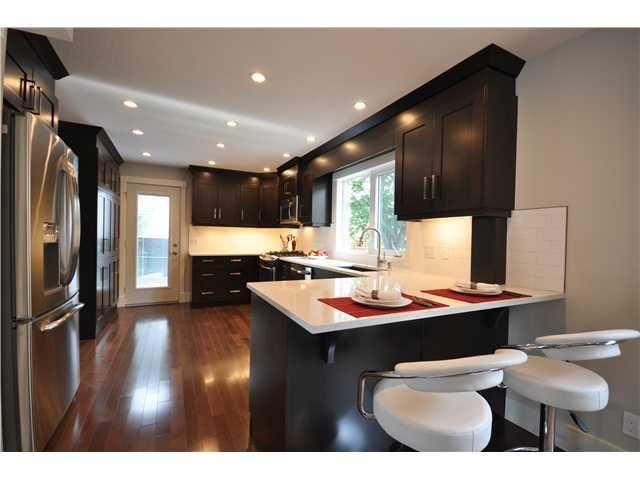 Photo 4: Photos: 1048 LAKE TWINTREE Drive SE in Calgary: Lake Bonavista Residential Detached Single Family for sale : MLS®# C3641174