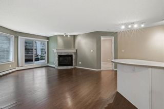 Photo 2: 107 20 Sierra Morena Mews SW in Calgary: Signal Hill Apartment for sale : MLS®# A1136105
