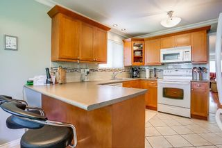 Photo 5: 8736 TULSY Crescent in Surrey: Queen Mary Park Surrey House for sale : MLS®# R2192315