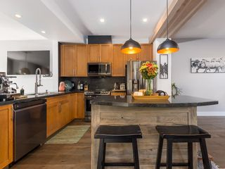 """Photo 1: 10 40632 GOVERNMENT Road in Squamish: Brackendale Townhouse for sale in """"Riverswalk"""" : MLS®# R2620887"""