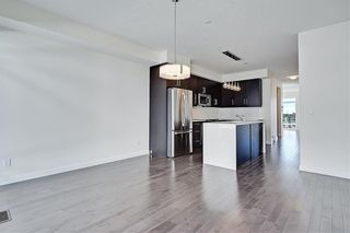 Photo 7: 1 3814 Parkhill Place SW in Calgary: Parkhill Row/Townhouse for sale : MLS®# A1121191