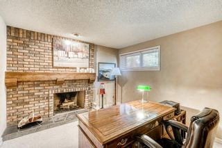 Photo 34: 555 Coach Light Bay SW in Calgary: Coach Hill Detached for sale : MLS®# A1144688