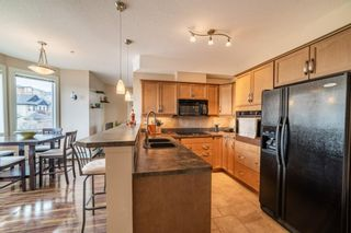 Main Photo: 432 26 VAL GARDENA View SW in Calgary: Springbank Hill Apartment for sale : MLS®# A1100286