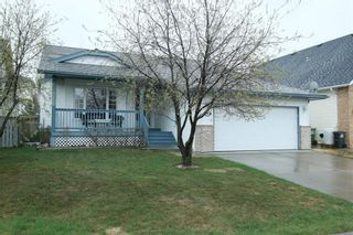 Photo 1: 185 WEST MCDOUGAL Road: Cochrane House for sale : MLS®# C4184033