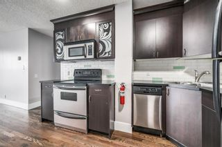 Photo 2: 305 1530 16 Avenue SW in Calgary: Sunalta Apartment for sale : MLS®# A1131555