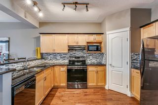 Photo 7: 109 Country Hills Gardens NW in Calgary: Country Hills Semi Detached for sale : MLS®# A1136498