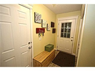 Photo 2: 58 CRYSTAL SHORES Cove: Okotoks Townhouse for sale : MLS®# C3643432